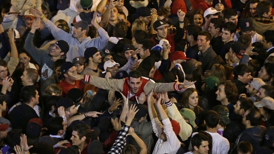 October 30, 2013: Boston Red Sox fans celebrate after Boston defeated St. Louis Cardinals in Game 6 of baseball's World Series Wednesday in Boston. The Red Sox won 6-1 to win the series. (AP Photo/Charlie Riedel)