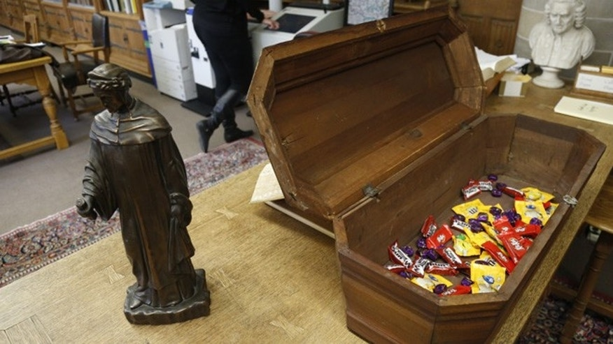 Oct. 29, 2013: This shows an actual child's coffin filled with candy at the McCormick Library of Special Collections in Evanston, Ill.