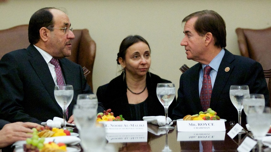Iraq's Prime Minister Nouri al-Maliki, left, talks with House Foreign Affairs Committee Chairman Rep. Ed Royce, R-Calif., right, during a luncheon meeting on Capitol Hill in Washington, Wednesday, Oct. 30, 2013.  (AP Photo/Molly Riley)