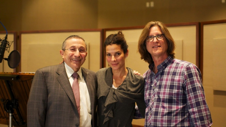 "This March 2013 photo released by Moriah Films shows, from left, Rabbi Marvin Hier, actress Sandra Bullock, and Moriah Films director Richard Trank, during a recording session at DreamWorks Animation Studio in Burbank, Calif. The Wiesenthal Center's Oscar-winning film division, issues its 13th historical movie, ""The Prime Ministers,"" on Nov. 6, 2013. Bullock is the voice of Golda Meir in the documentary.  (AP Photo/Moriah Films, Nimrod Erez)"