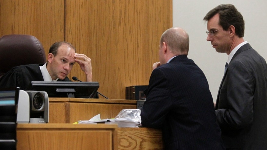 Judge Derek Pullan, left, speaks to prosecuter Chad Grunander, secon from left, and defense lawyer Randy Spencer during a break in testimony of Alexis Somers, right at the Martin MacNeill trial in Provo, Utah, Thursday, Oct. 31, 2013.   MacNeill is charged with murder in the death of his wife, Michele MacNeill, in 2007.  (AP Photo/The Salt Lake Tribune, Al Hartmann,pool )