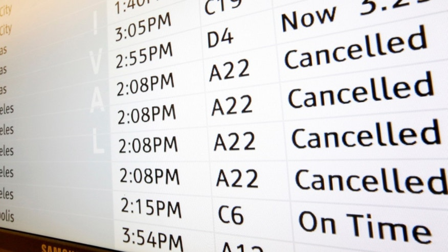 "An arrivals monitor at Phoenix International Airport shows flights  scheduled to arrive from Los Angeles International Airport, from a variety of airline carriers, as ""canceled"" on Friday, Nov. 1, 2013, in Phoenix.  A man pulled a rifle from a bag and shot his way past a security checkpoint at Los Angeles International Airport on Friday, killing one Transportation Security Administration officer and wounding several others, authorities said. (AP Photo/Ross D. Franklin)"