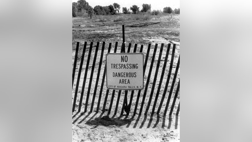 Aug. 2, 1978: This file photo shows a fence and a sign cordoning off a contaminated toxic waste dump site in the Love Canal neighborhood of Niagara Falls, N.Y.