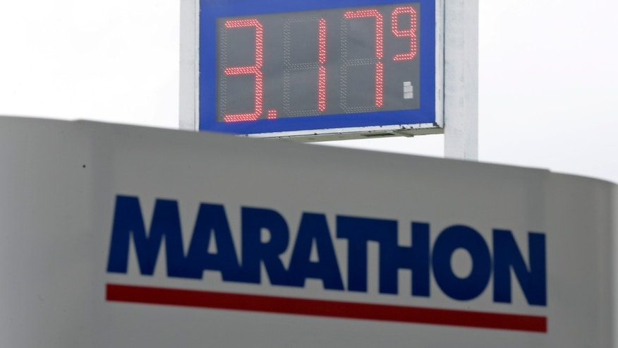 Oct. 24, 2013: Gas prices drop to $3.17 at a Marathon station in Kokomo, Ind.