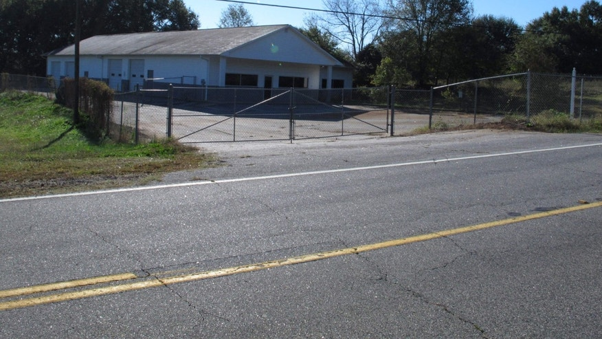The building that once housed Superbike Motorsports sits empty on Wednesday, Oct. 24, 2013, in Chesnee, S.C. The building has been abandoned since four people who worked in the shop were shot to death in November 2003. No arrests have been made in the killings. (AP Photo/Jeffrey Collins)