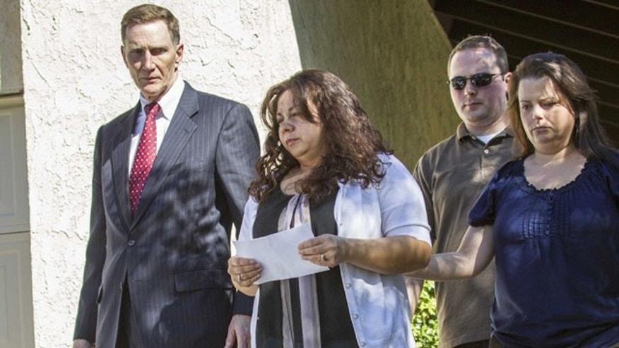 November 2, 2013: John S. Pistole, left, Administrator of Transportation Security Administration and Ana Hernandez, center, wife of TSA agent Gerardo Hernandez, victim at LAX shooting, before a press conference in Porter Ranch, Calif. (AP Photo)
