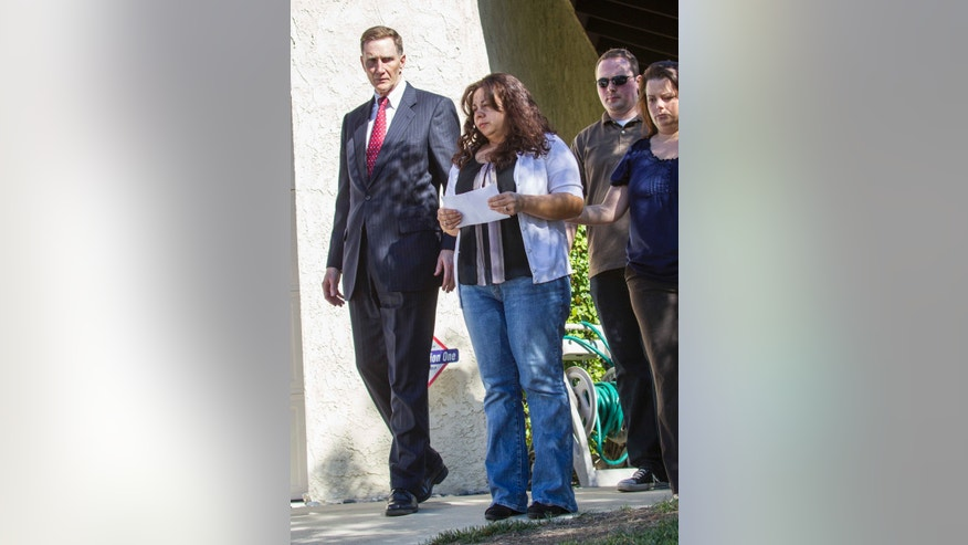 John S. Pistole, left, Administrator of Transportation Security Administration and Ana Hernandez, center, wife of  TSA agent Gerardo Hernandez, victim at LAX shooting, before a press conference in Porter Ranch, Calif. on Saturday Nov. 2, 2013. A gunman armed with a semi-automatic rifle opened fire at Los Angeles International Airport on Friday, killing a Transportation Security Administration employee and wounding two other people in an attack that frightened passengers and disrupted flights nationwide. (AP Photo/Ringo H.W. Chiu)