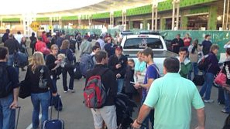 Nov. 3, 2013: People stand outside after the terminal at Birmingham-Shuttlesworth International Airport was evacuated because of a threat.