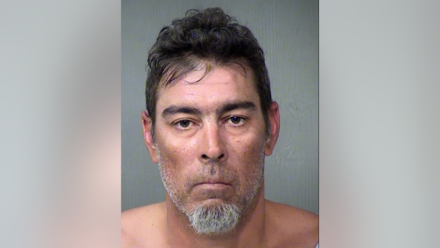 """This undated photo provided by the Maricopa County Sheriff's Office shows Jason Eric Howell in Phoenix.  Police say that Howell is a """"person of interest"""" in the case of a 78-year-old suburban Phoenix woman, who disappeared this week and also faces charges stemming from an unrelated carjacking in another Phoenix suburb. (AP Photo/Maricopa County Sheriff's Office)"""