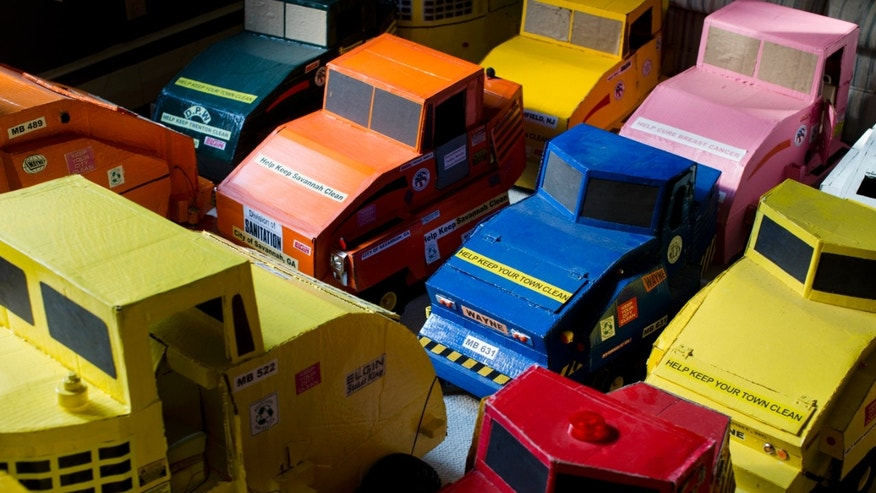 Model street sweepers made by McKinley Page sit in his home Thursday, Oct. 24, 2013, in Bethlehem, Pa. Ever since age 4, Page has been mesmerized by street sweepers and now spends his days hand-making miniature models after the machines in dozens of New Jersey towns and writing fan letters to street sweeping manufacturers around the United States. (AP Photo/Matt Rourke)