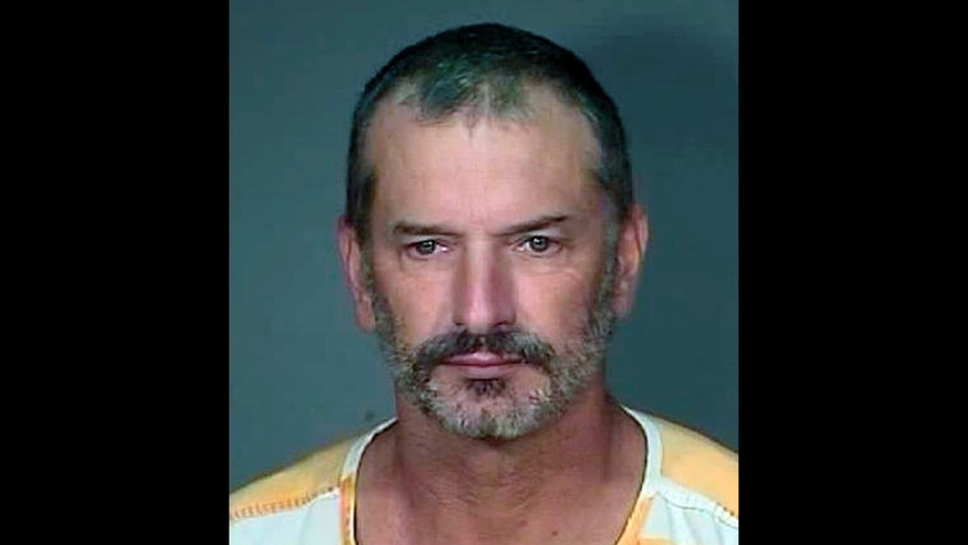 FILE - This Aug. 19, 2010 file photo provided by the Mohave County Sheriff's Office shows Arizona inmate John Charles McCluskey after he was captured at a campsite in the Apache-Sitgreaves National Forest in Ariz.  Federal prosecutors and defense attorneys for convicted killer John McCluskey are scheduled to deliver closing arguments Monday, Nov. 4, 2013,  in the first phase of his sentencing trial.  It will be up to jurors to decide whether the death penalty will be an option as they consider punishing McCluskey for the August 2010 slayings of an Oklahoma couple following his escape from an Arizona prison. (AP Photo/Mohave County Sheriff's Office, File)