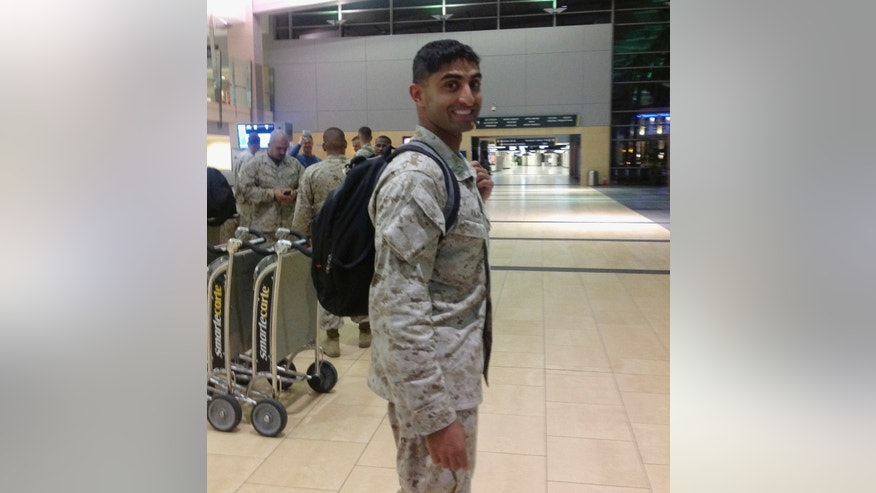 "This Monday, Nov. 4, 2013 photo provided by Pravin Rajan shows Marine Capt. Pravin Rajan after his arrival at San Diego International Airport in San Diego following in a tour of duty Afghanistan. Rajan was part of a group of 13 Marines that got a heroes welcome at Chicago's International Airport four days into a journey back home by of a small crowd of cheering USO volunteers, firefighters, police officers and others who work at the airport. Rajan says the reception he and his comrades received on their way to San Diego was ""incredibly touching.""  (AP Photo/Courtesy of Pravin .Rajan, Sandhya Rajan)"