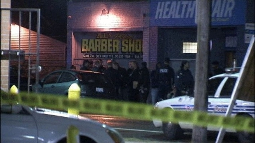 November 6, 2013: Police on the scene of the shooting outside Al's Barber Shop in Detroit. (MyFoxDetroit.com)