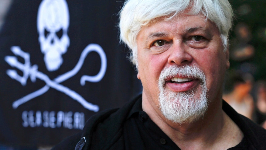 FILE - In this May 23, 2012 file picture Paul Watson, founder and President of the animal rights and environmental group Sea Shepherd Conservation takes part in a demonstration against the Costa Rican government near Germany's Presidential residence during a visit of Costa Rica's president Laura Chinchilla in Berlin, Germany. Watson a fugitive anti-whaling activist known for confronting Japanese whaling vessels off Antarctica is due to testify about his actions in a U.S. court Wednesday Nov. 6, 2013. (AP Photo/Markus Schreiber, File)