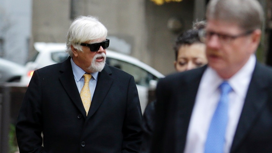 Paul Watson, left, the fugitive anti-whaling activist, arrives at a federal courthouse, Wednesday, Nov. 6, 2013 in Seattle. Watson, founder of the Oregon-based Sea Shepherd Conservation Society, is expected to take the witness stand in a contempt of court hearing that is part of a long-running fight between protesters and Japan's whaling fleet. (AP Photo/Ted S. Warren)