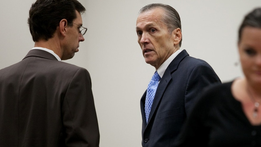 Martin MacNeill speaks to his attorney Randy Spencer, left, before proceedings at the Fourth District Court in Provo Tuesday, Nov. 5, 2013. MacNeill is charged with murder for allegedly killing his wife Michele MacNeill in 2007. (AP Photo/Daily Herald, Mark Johnston, Pool)