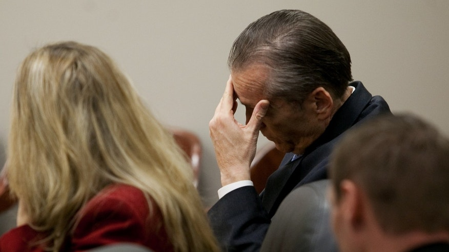 Martin MacNeill rubs his head during his trial at the Fourth District Court in Provo Tuesday, Nov. 5, 2013. MacNeill is charged with murder for allegedly killing his wife Michele MacNeill in 2007. (AP Photo/Daily Herald, Mark Johnston, Pool)