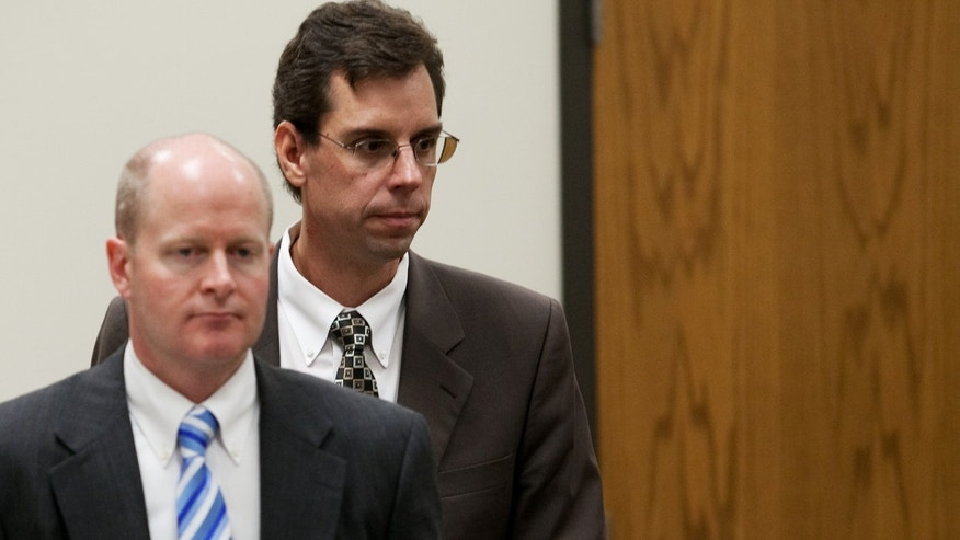 Prosecutor Chad Grunander, left, and defense attorney Randy Spencer return to their seats during the trial of Martin MacNeill at the Fourth District Court in Provo Tuesday, Nov. 5, 2013. MacNeill is charged with murder for allegedly killing his wife Michele MacNeill in 2007. (AP Photo/Daily Herald, Mark Johnston, Pool)