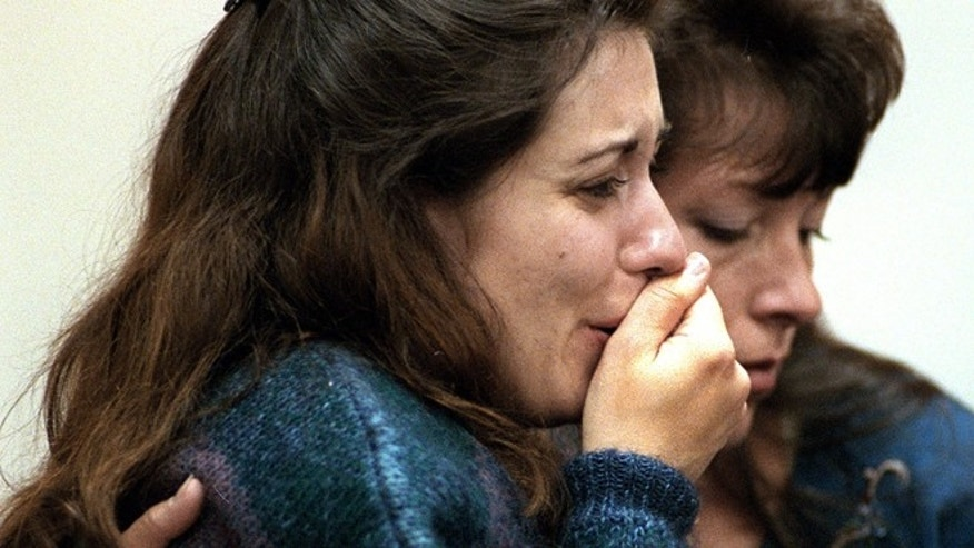 FILE 1997: Celeste Caulley, wife of defendant Robert Caulley, and his sister Patti Deblo react to the guilty verdict that was handed down. While Robert Caulley was trying to prove that he didn't murder his parents nearly 15 years ago, his defense attorney and wife were reportedly engaged in a romantic affair before, during and after the trial.