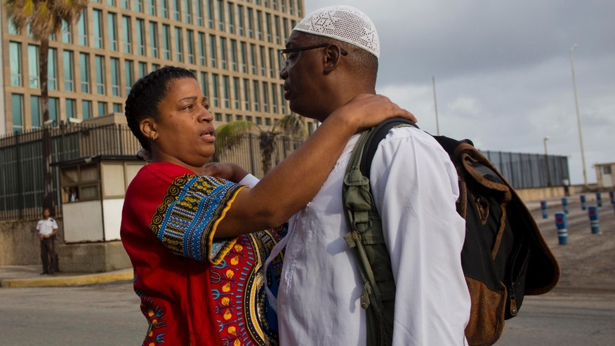 U.S. citizen William Potts and his wife Aime Quesada say goodbye outside the U.S. Interests Section before he is escorted to the airport by U.S. officials in Havana, Cuba, Wednesday, Nov. 6, 2013. On Wednesday, nearly three decades after he forced an airliner to bring him to the Communist-run island, he was heading back to the U.S. and an uncertain legal future. FBI agents took the 56-year-old Potts into custody Wednesday shortly after his charter flight from Havana arrived at Miami International Airport. (AP Photo/Ramon Espinosa)