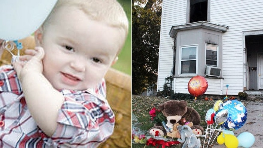 In this Nov. 3, 2013 photo provided by the Louisiana Press-Journal is a memorial in front of a home following a fire in Louisiana, Mo. The family of 3-year-old Riley Miller who was killed in the Oct. 31 fire says it is outraged after police used a stun gun on the boy's stepfather as he tried to run back in and save the child.