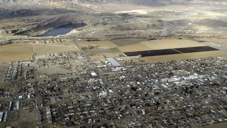 FILE - This Jan. 28, 2004 file aerial photo shows the Yerington mine site, adjacent to the small farming town of Yerington, Nev. (AP Photo)