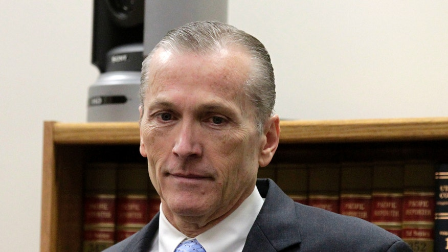 Martin MacNeill arrives for closing arguments on the final day of his murder trial in Provo, Utah, 4th District Court on Friday, Nov. 8, 2013.  MacNeill is charged with murder for allegedly killing his wife, Michele MacNeill, in 2007.  (AP Photo/The Salt Lake Tribune, Al Hartmann, Pool)