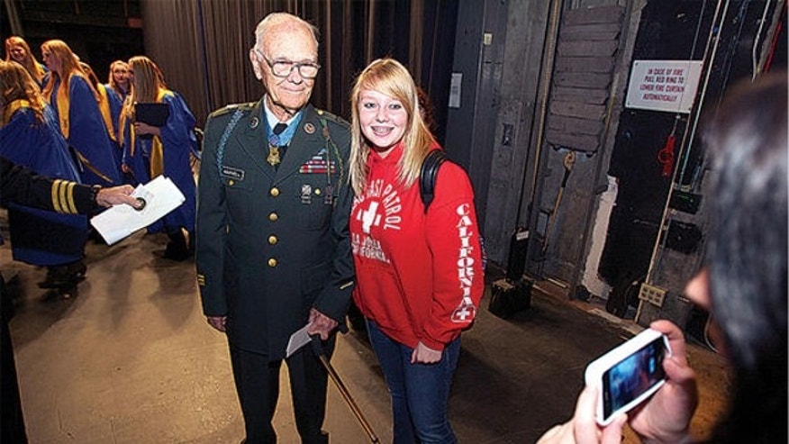 FILE: Nov. 8, 2012: World War II Medal of Honor recipient Bob Maxwell posing for a picture with Ashlyn Pistey following a ceremony honoring veterans at Bend High School in Bend, Ore.