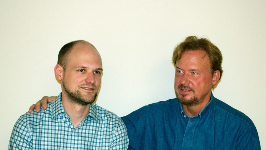 "In this Sept. 2013 photo provided by The Rev. Frank Schaefer shows Schaefer, right,  and his son Tim. The Rev. Frank Schaefer knew that church law forbade him from officiating his gay son's 2007 wedding in Massachusetts, but went ahead and did it anyway ""because I love him so much and didn't want to deny him that joy."" The decision could cost him his pastor's credentials. Schaefer faces a church trial in southeastern Pennsylvania later this month, the latest flashpoint in a debate that has long roiled the nation's largest mainline Protestant denomination. (AP Photo/ Schaefer Family)"