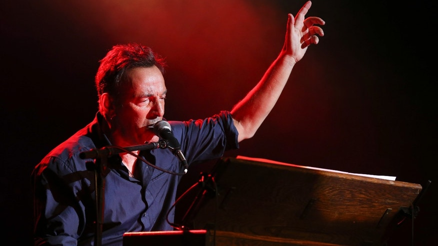 Musician Bruce Springsteen performs at the Stand Up for Heroes event at Madison Square Garden, Wednesday, Nov. 6, 2013, in New York. (John Minchillo/Invision/AP)