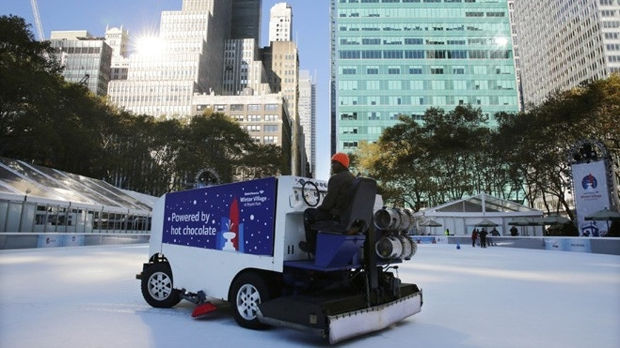 Nov. 10, 2013: The ice rink at Bryant Park in New York is resurfaced. A shooting at the ice rink at the popular midtown Manhattan park late Saturday sent two men to the hospital with non-life-threatening injuries, police said.