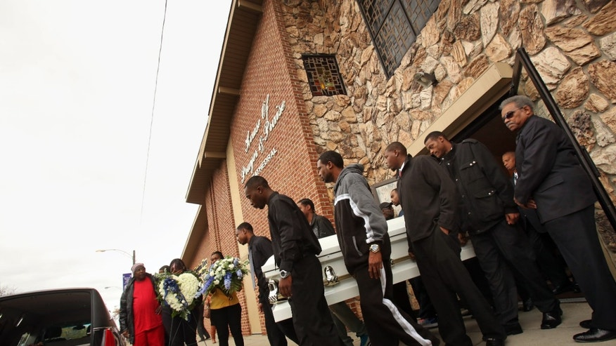 Pallbearers carry the coffin of 19-year-old Renisha McBride after her funeral service at House of Prayer & Praise Cathedral in Detroit on Friday, Nov. 8, 2013. McBride was shot and killed by a Dearborn Heights home owner in the early morning hours of Saturday, November 2 after she approached his house. About two hours before the shooting, McBride had been involved in an auto accident nearby. (AP Photo/Detroit Free Press, Brian Kaufman)