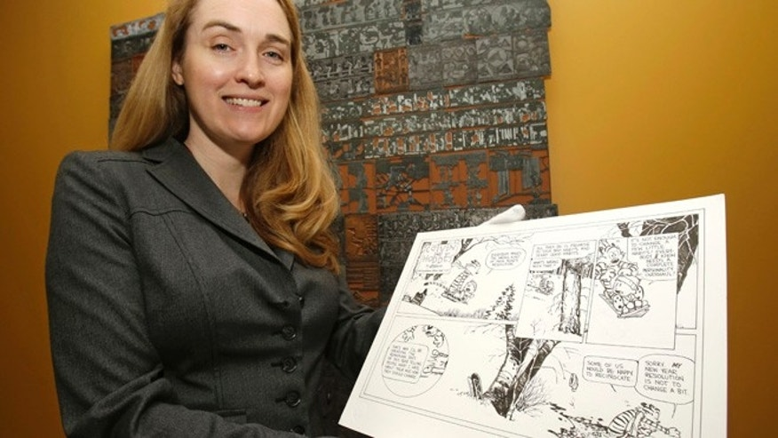 "Oct. 23, 2013: In this photo, Juli Slemmons holds a ""Calvin and Hobbes"" comic by cartoonist Bill Watterson at the Billy Ireland Cartoon Library & Museum in Columbus, Ohio. Today the museum collection includes more than 300,000 original strips from everybody whos anybody in the newspaper comics world, plus 45,000 books, 29,000 comic books and 2,400 boxes of manuscript material, correspondence and other personal papers from artists."