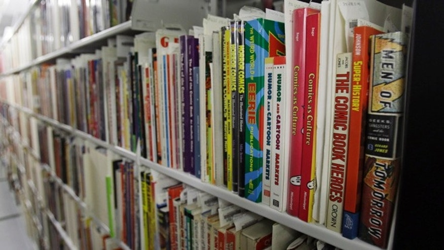 Oct. 23, 2013: This photo shows rows of books on cartoons at the Billy Ireland Cartoon Library & Museum in Columbus, Ohio.
