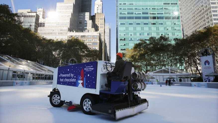 The ice rink at Bryant Park in New York is resurfaced on Sunday, Nov. 10, 2013. A shooting at the ice rink at the popular midtown Manhattan park late Saturday sent two men to the hospital with non-life-threatening injuries, police said.  (AP Photo/Peter Morgan)
