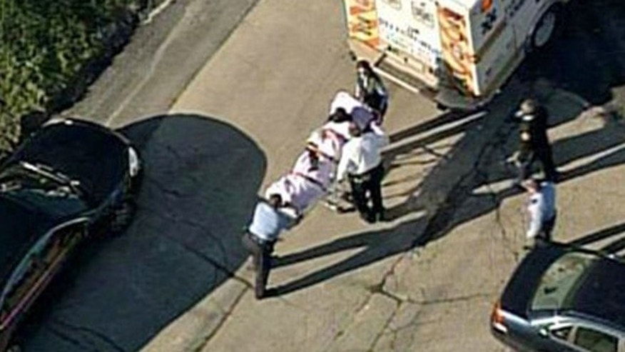 Nov. 13, 2013: In this aerial image provided by KDKA-TV, a person is loaded into an ambulance near Brashear High School in Pittsburgh.