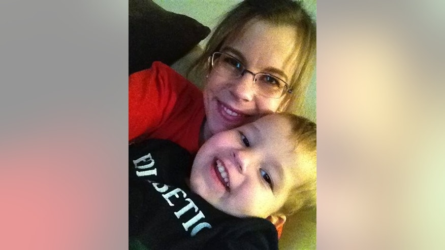 Nov. 9, 2013: Stephanie Metz poses for a photo with her 2-year-old son Jameson in Rapid City, S.D.