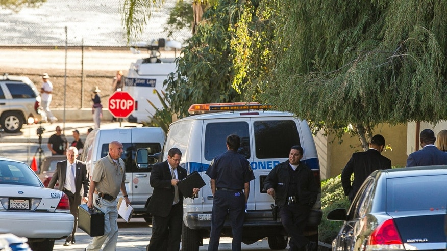 Los Angeles County Coroner officials and investigators arrive at the residence of Joseph Gatto in Los Angeles Thursday, Nov. 14, 2013. California Assemblyman Mike Gatto's father Joseph Gatto was fatally shot in this Los Angeles home, authorities said.  Gatto, 78, was found late Wednesday at his home in Silver Lake, police said. A family member arrived at the home and discovered Gatto shot at least one time and that the home had been ransacked, police said. (AP Photo/Damian Dovarganes)