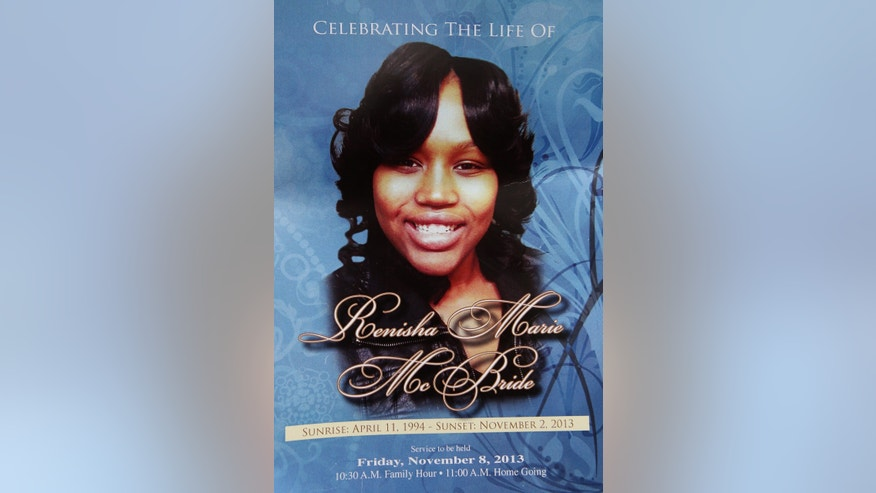 In this Nov. 8, 2013 file photo is the front cover of a funeral program for 19-year-old Renisha McBride from a service at House of Prayer & Praise Cathedral in Detroit. Prosecutors announced Thursday, Nov. 14, 2013 that they have scheduled a news conference Friday in Detroit to announce whether they'll charge a suburban Detroit homeowner in the shooting death of McBride.  (AP Photo/Detroit Free Press, Brian Kaufman)  DETROIT NEWS OUT;  NO SALES;