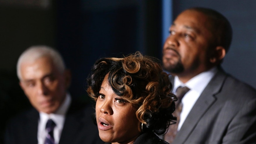 Monica McBride, center, and Walter Ray Simmons, right, the parents of Renisha McBride address the media with attorney Gerald Thurswell, left, during a news conference in Southfield, Mich., Friday, Nov. 15, 2013. Their daughter was shot on Nov. 2  in the face on Theodore P. Wafer's front porch in Dearborn Heights. (AP Photo/Carlos Osorio)