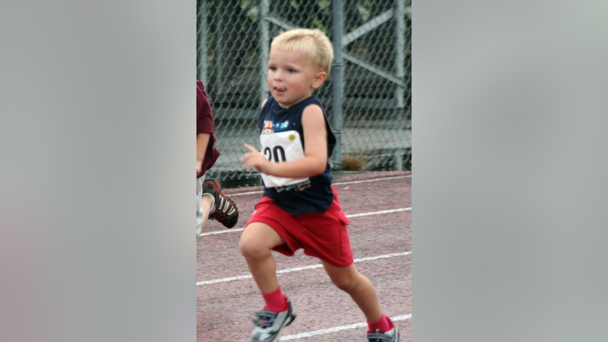 In this 2009 file photo provided by the Kowalski family, Chase Kowalski, at 2½ years old, runs in a race at Bethel High School in Bethel, Conn. Chase Kowalski loved to race, whether it was running, swimming or riding his bike. The 7-year-old, one of 26 people killed last Dec. 14 inside the Sandy Hook Elementary school, ran competitively for the first time when he was just 2½ years old. His parents decided to honor Chase's memory by a starting a foundation, raising money for children's fitness projects, family wellness and preschool education scholarships. (AP Photo/Kowalski family)
