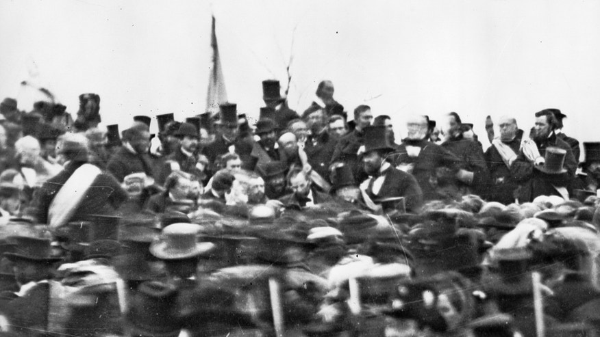 """This Nov. 19, 1863 photo made available by the Library of Congress shows President Abraham Lincoln, center with no hat, surrounded by the crowd at the dedication of a portion of the battlefield at Gettysburg, Pa. as a national cemetery. The Gettysburg Address is unusual among great American speeches, in part because the occasion did not call for a great American speech. Lincoln was not giving an inaugural address, a commencement speech or remarks in the immediate aftermath of a shocking national tragedy. """"No one was looking for him to make history,"""" says the Pulitzer Prize winning Civil War historian James McPherson. (AP Photo/Library of Congress, Alexander Gardner)"""