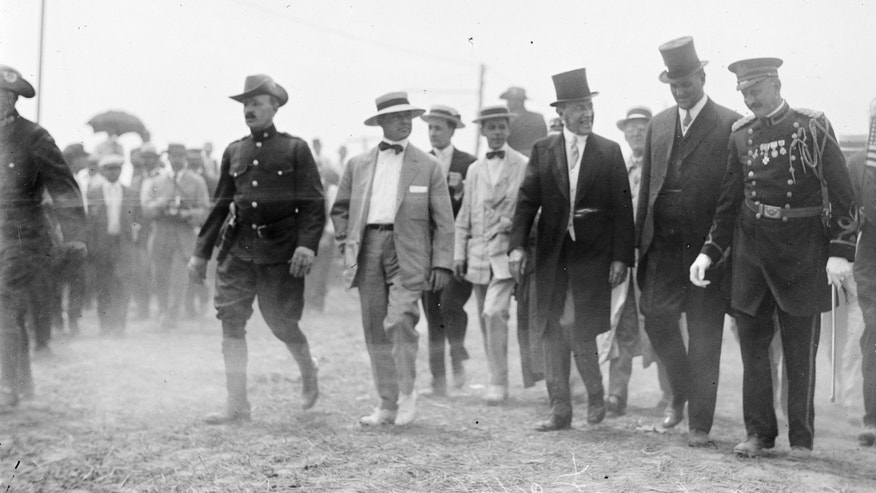 "In this July 1913 photo made available by the Library of Congress, President Woodrow Wilson, third from right, attends a commemoration for the 50th anniversary of the Battle of Gettysburg. After Abraham Lincoln, the first major presidential address at Gettysburg was given at this event by Wilson, who privately ranked Lincoln's speech as ""very, very high,"" and offered a vague tribute to national unity that disappointed admirers of a man whose speechmaking had enabled his quick rise from Princeton president to the White House. According to a new biography by A. Scott Berg, Wilson was a reluctant guest of honor. He initially turned down an invitation and gave in only after being warned that the Virginia-born president would be perceived as hostile to a gathering attended by veterans from both sides. (AP Photo/Library of Congress)"