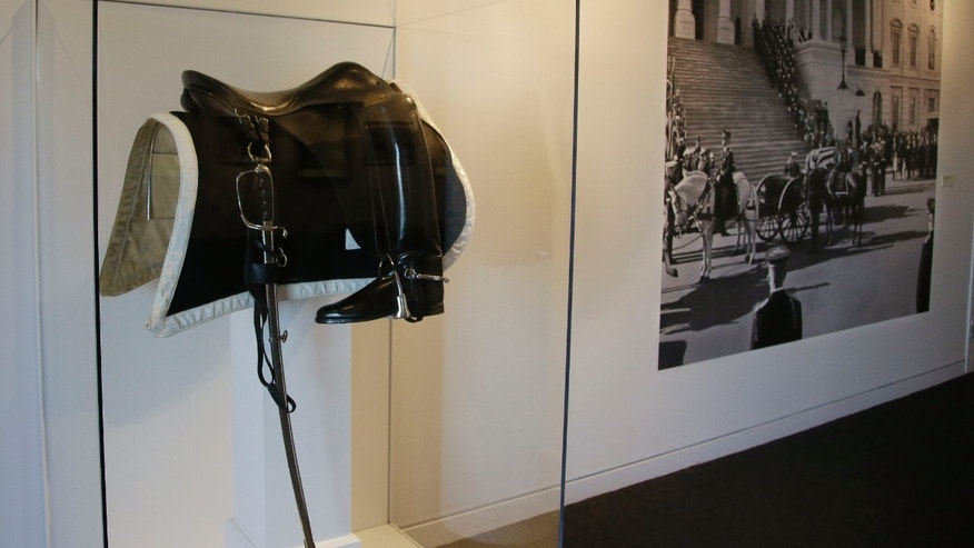 A small new exhibit at the John F. Kennedy Library and Museum marking the 50th anniversary of the assignation of the 35th President of the United States includes never-before-displayed artifacts from his three-day state funeral, such as the saddle, boots and sword which sat atop the riderless horse in Kennedy's funeral procession in Boston, Thursday, Nov. 14, 2013. The riderless horse is symbolic of a fallen leader who will never ride again. (AP Photo/Stephan Savoia)