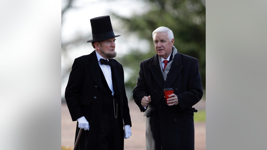 Pennsylvania Gov. Tom Corbett, right, speaks with James Getty, portraying President Abraham Lincoln, before a ceremony commemorating the 150th anniversary of the dedication of the Soldiers' National Cemetery and President Abraham Lincoln's Gettysburg Address, Tuesday Nov. 19, 2013, in Gettysburg, Pa.  Lincoln's speech was first delivered in Gettysburg nearly five months after the major battle that left tens of thousands of men wounded, dead or missing. Getty is scheduled to deliver the Gettysburg Address at Tuesday's ceremony.  (AP Photo/Matt Rourke)