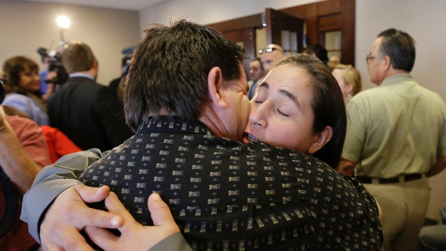 Nov. 18, 2013: Anna Vasquez, right, is hugged by family as she leaves a courtroom at the Bexar County Courthouse in San Antonio, after it was announced that three of four San Antonio women imprisoned for sexually assaulting two girls in 1994 were expected to walk free after a judge agreed that their convictions were tainted by faulty witness testimony. Vasquez, the fourth woman, has already been paroled, but under strict conditions.