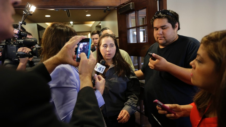Nov. 18, 2013: Anna Vasquez, center, walks past members of the media as she leaves a courtroom at the Bexar County Courthouse in San Antonio, after it was announced that three of four San Antonio women imprisoned for sexually assaulting two girls in 1994 were expected to walk free after a judge agreed that their convictions were tainted by faulty witness testimony.