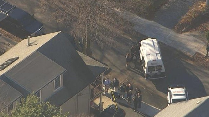 Nov. 18, 2013: Authorities investigate a home in Arlington, Mass., after four bodies were found inside Monday.