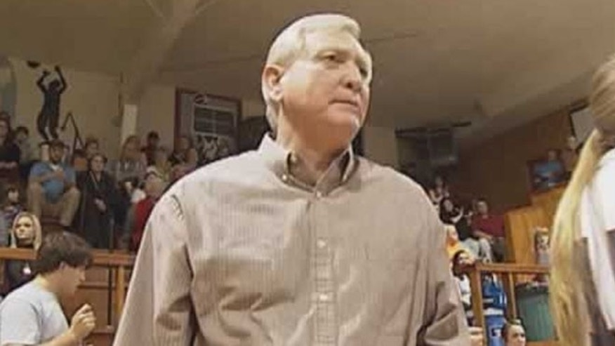 Leake Academy girls' basketball coach, Doyle Wolverton, steps down after allegations that he bit player.