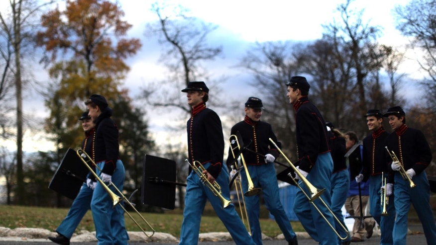 Band members arrive before a ceremony commemorating the 150th anniversary of the dedication of Soldiers' National Cemetery and President Abraham Lincoln's Gettysburg Address, Tuesday Nov. 19, 2013, in Gettysburg, Pa. Lincoln's speech was first delivered here nearly five months after the pivotal battle which was the Civil War's bloodiest conflict with more than 51,000 casualties. (AP Photo/Matt Rourke)